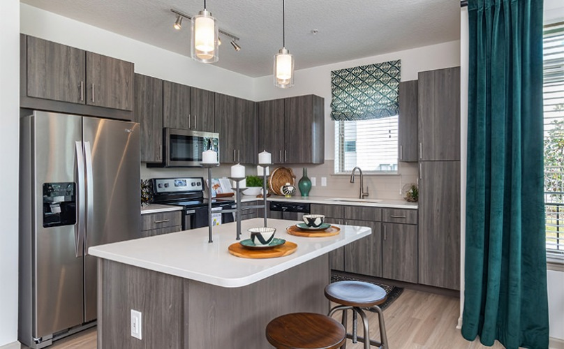 open kitchen with island and windows